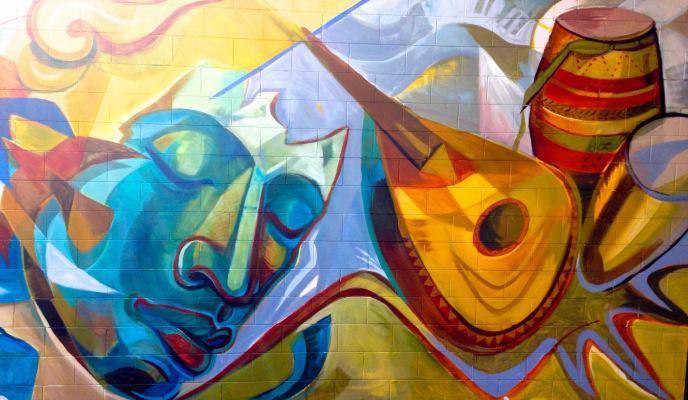 a close up of the mural, a face floating with instruments. This mural was an opportunity to contribute to the landscape of public works in my hometown!